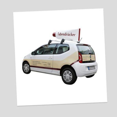 Fahrzeugbeschriftung - Tubendrücker